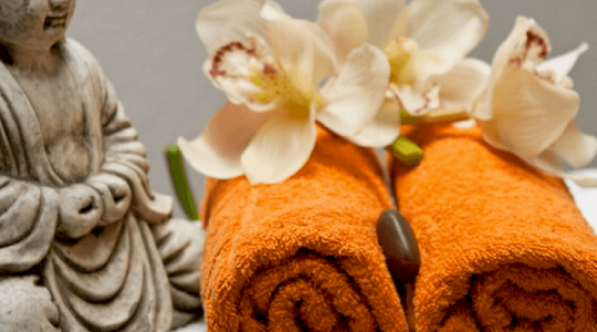 orange towels with buddha and flowers